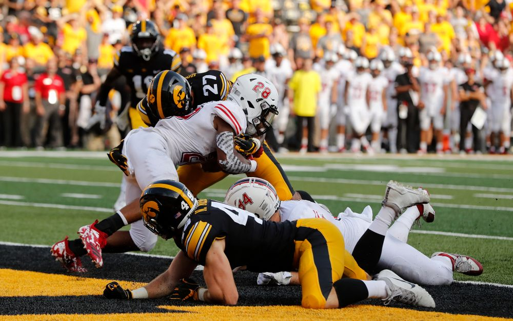 Iowa Hawkeyes defensive back Amani Hooker (27) stops Northern Illinois Huskies running back Jordan Nettles (28) in the end zone for a safety Saturday, September 1, 2018 at Kinnick Stadium. (Brian Ray/hawkeyesports.com)