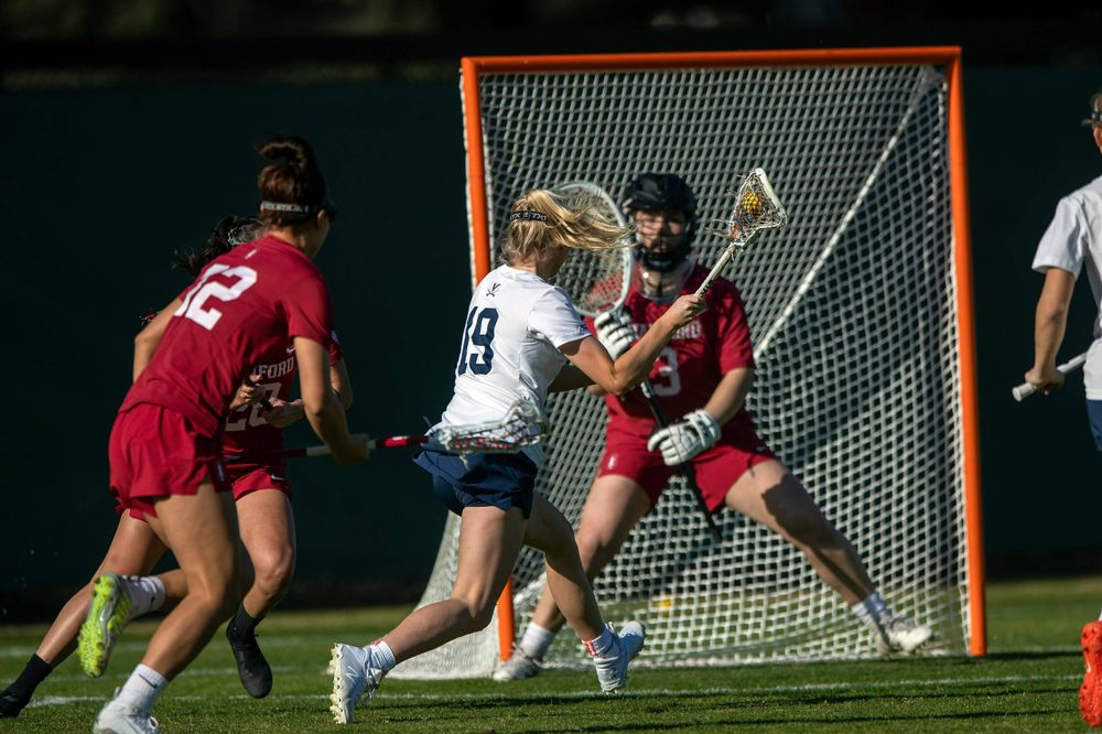 STANFORD, California - FEBRUARY 14:  Virginia Cavaliers midfield Annie Dyson (19) shoots against Stanford Cardinal goalkeeper Trudie Grattan (3) during the first half at Cagan Stadium on February 14, 2020 in Stanford, California. The Virginia Cavaliers defeated the Stanford Cardinal 12-11. (Photo by Jason O. Watson)