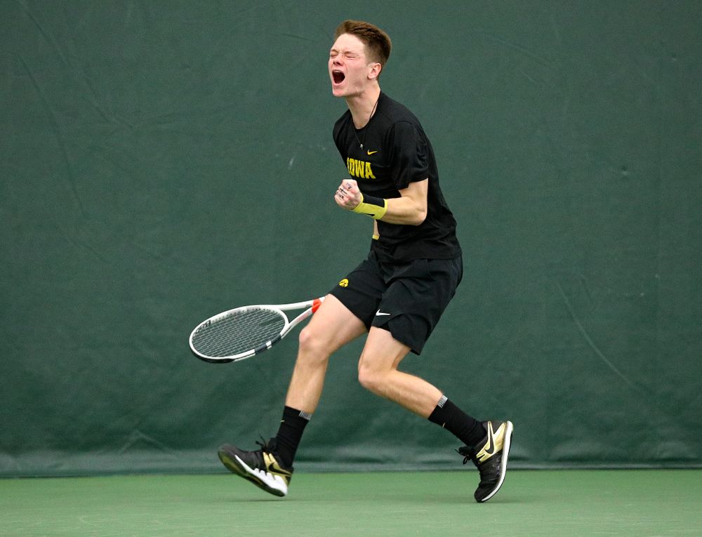 Iowa's Jason Kerst celebrates a point during his singles match at the Hawkeye Tennis and Recreation Complex in Iowa City on Friday, February 14, 2020. (Stephen Mally/hawkeyesports.com)