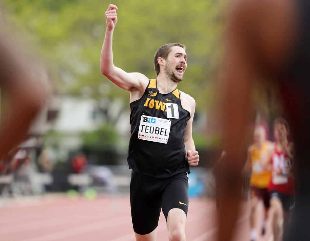 Iowa's Nolan Teubel pumps his fist as he crosses the finish line during the men's 800 meter event on the second day of the Big Ten Outdoor Track and Field Championships at Francis X. Cretzmeyer Track in Iowa City on Saturday, May. 11, 2019. (Stephen Mally/hawkeyesports.com)