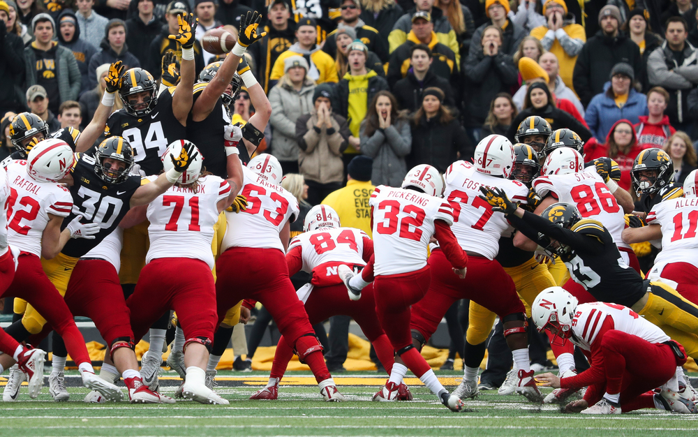 Iowa Hawkeyes defensive back Jake Gervase (30), Iowa Hawkeyes defensive end A.J. Epenesa (94) and Iowa Hawkeyes defensive end Anthony Nelson (98) try to block a field goal during a game against Nebraska at Kinnick Stadium on November 23, 2018. (Tork Mason/hawkeyesports.com)