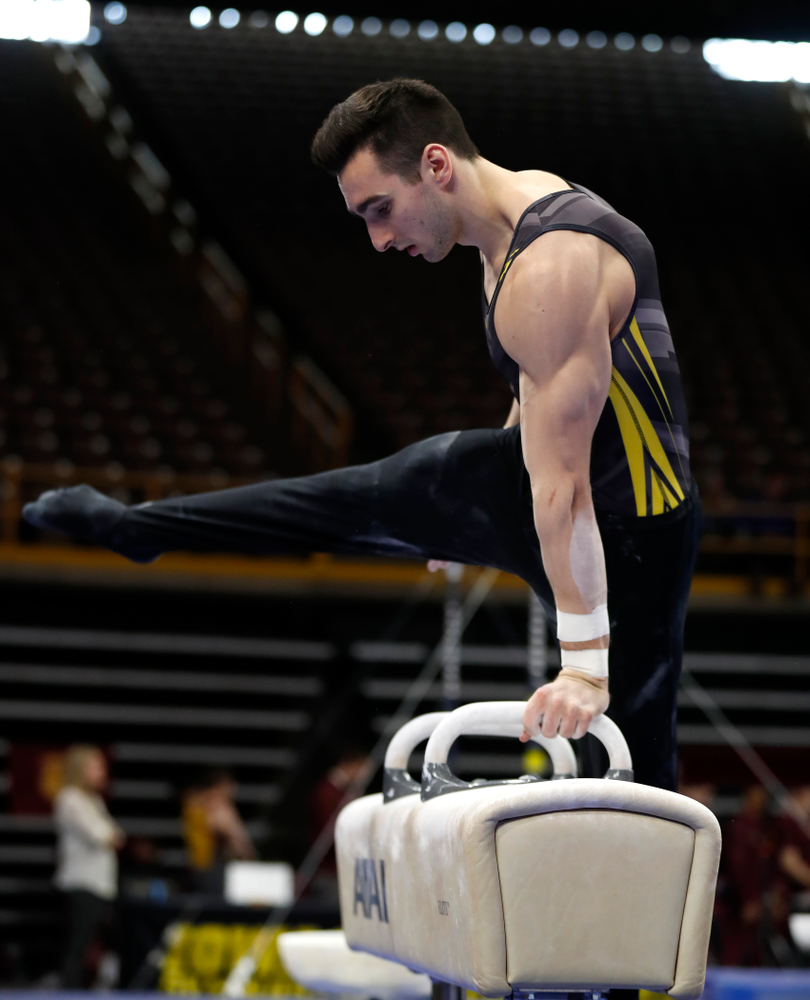 Austin Hodges competes on the pommel horse  against Minnesota and Air Force