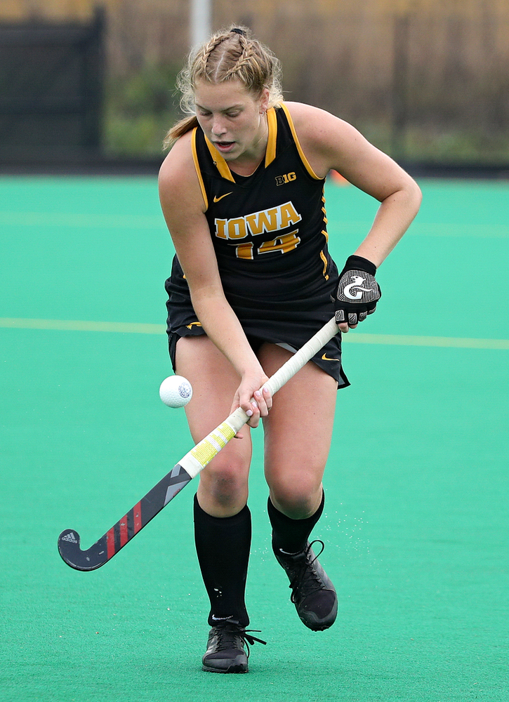 Iowa's Lokke Stribos (14) bounces the ball on her stick during the second quarter of their game at Grant Field in Iowa City on Saturday, Oct 26, 2019. (Stephen Mally/hawkeyesports.com)