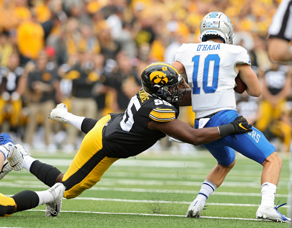 Iowa Hawkeyes defensive lineman Cedrick Lattimore (95) sacks Middle Tennessee State quarterback Asher O'Hara (10) during the first quarter of their game at Kinnick Stadium in Iowa City on Saturday, Sep 28, 2019. (Stephen Mally/hawkeyesports.com)