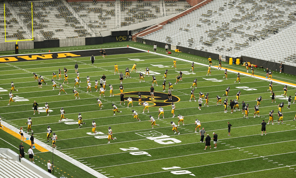 The Iowa Hawkeyes warm up during Fall Camp Practice No. 12 at Kinnick Stadium in Iowa City on Thursday, Aug 15, 2019. (Stephen Mally/hawkeyesports.com)