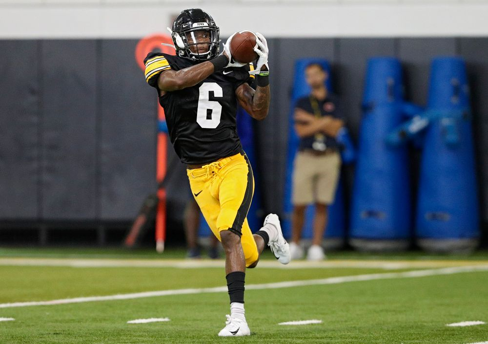 Iowa Hawkeyes wide receiver Ihmir Smith-Marsette (6) pulls in a pass during Fall Camp Practice No. 6 at the Hansen Football Performance Center in Iowa City on Thursday, Aug 8, 2019. (Stephen Mally/hawkeyesports.com)