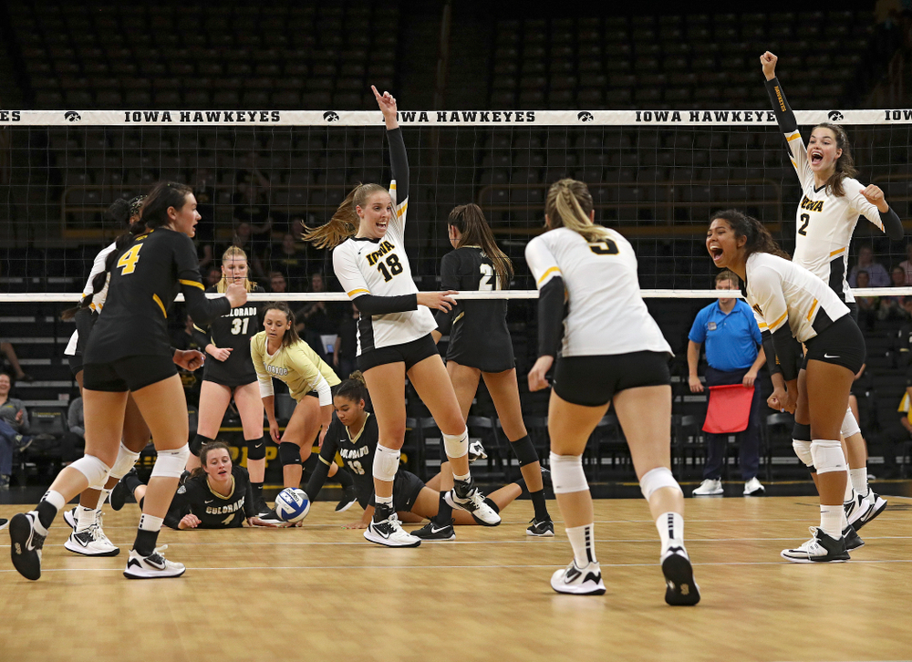 Iowa's Griere Hughes (10), Halle Johnston (4), Hannah Clayton (18), Meghan Buzzerio (5), Brie Orr (7), and Courtney Buzzerio (2) celebrate a score during the first set of their Big Ten/Pac-12 Challenge match against Colorado at Carver-Hawkeye Arena in Iowa City on Friday, Sep 6, 2019. (Stephen Mally/hawkeyesports.com)