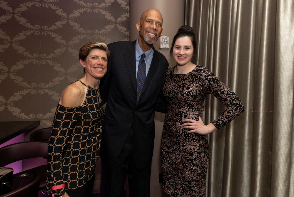 Iowa Hawkeyes forward Megan Gustafson (10) and associate head coach Jan Jensen with NBA great Kareem Abdul-Jabbar before the ESPN College Basketball Awards show Friday, April 12, 2019 at The Novo at LA Live.  (Brian Ray/hawkeyesports.com)