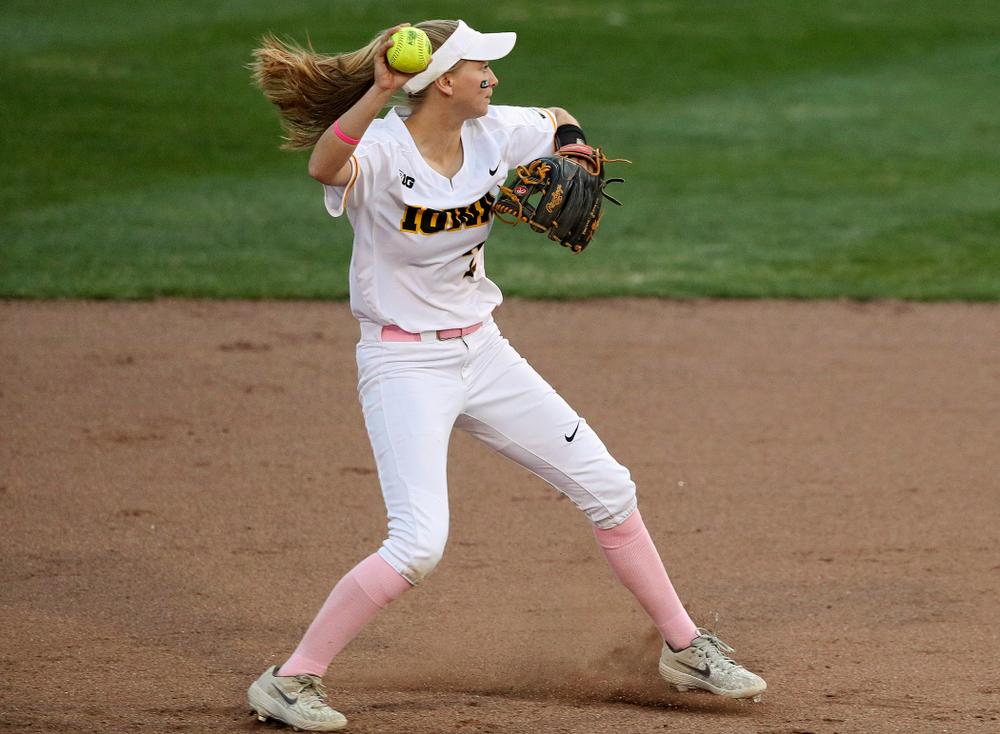 Iowa second baseman Aralee Bogar (2) throws to first as she turns a double play during the fifth inning of their game against Iowa State at Pearl Field in Iowa City on Tuesday, Apr. 9, 2019. (Stephen Mally/hawkeyesports.com)