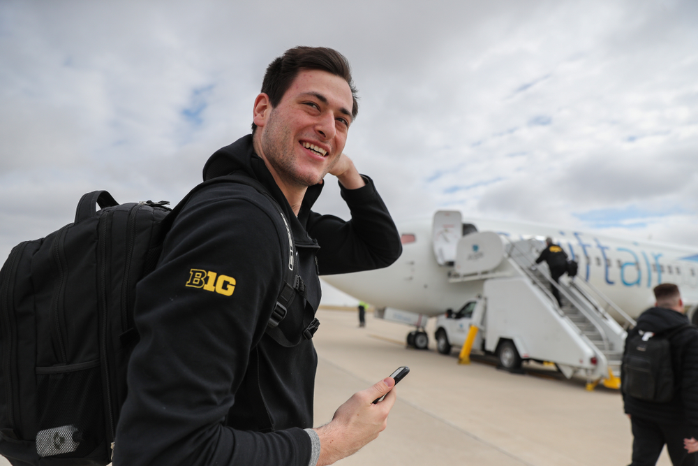 Iowa Hawkeyes forward Ryan Kriener (15) boards a flight to Columbus for the first and second rounds of the 2019 NCAA Men's Basketball Tournament Wednesday, March 20, 2019 at the Eastern Iowa Airport. (Brian Ray/hawkeyesports.com)