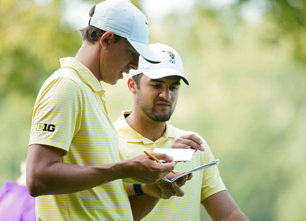 Iowa assistant coach Charlie Hoyle (from left) talks with Gonzalo Leal during the third day of the Golfweek Conference Challenge at the Cedar Rapids Country Club in Cedar Rapids on Tuesday, Sep 17, 2019. (Stephen Mally/hawkeyesports.com)