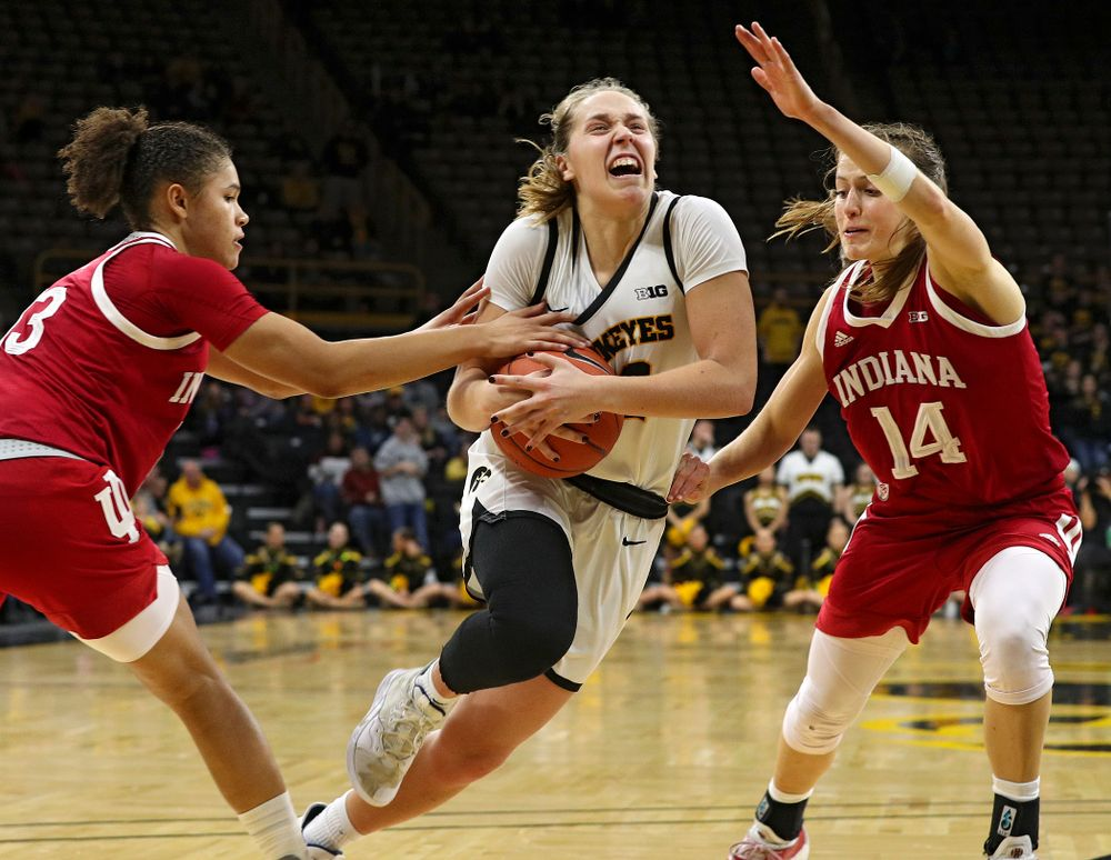 Iowa Hawkeyes guard Kathleen Doyle (22) drives to the basket and scores during the second overtime period of their game at Carver-Hawkeye Arena in Iowa City on Sunday, January 12, 2020. (Stephen Mally/hawkeyesports.com)