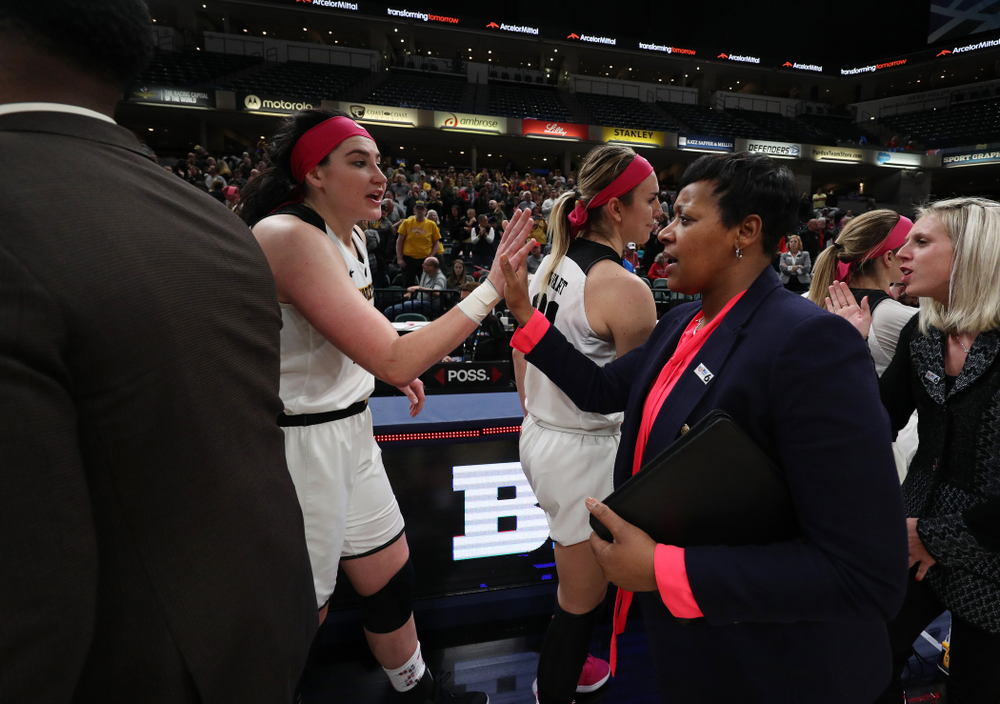 Iowa Hawkeyes forward Megan Gustafson (10) slaps hands with Rutgers Assistant Coach Michelle Edwards following their game in the semi-finals of the Big Ten Tournament Saturday, March 9, 2019 at Bankers Life Fieldhouse in Indianapolis, Ind. (Brian Ray/hawkeyesports.com)