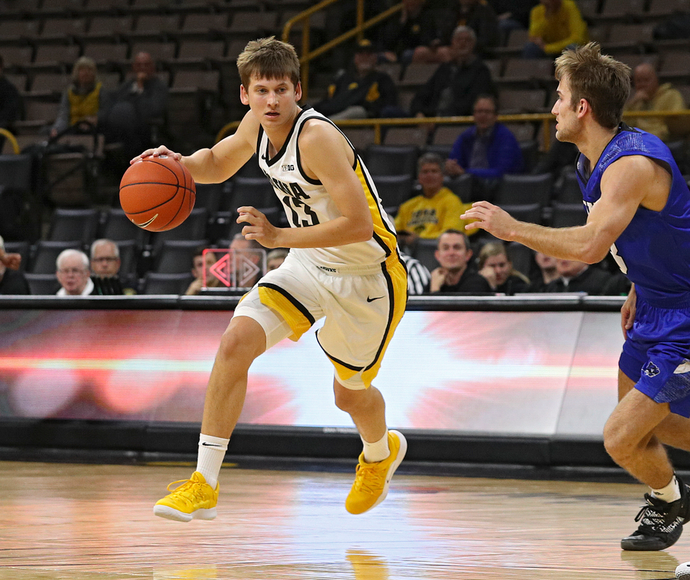 Iowa Hawkeyes guard Austin Ash (13) drives with the ball during the second half of their exhibition game against Lindsey Wilson College at Carver-Hawkeye Arena in Iowa City on Monday, Nov 4, 2019. (Stephen Mally/hawkeyesports.com)