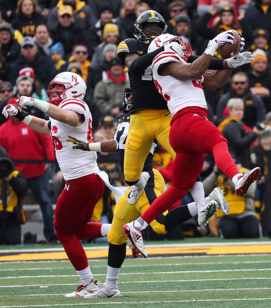 Iowa Hawkeyes defensive back Michael Ojemudia (11) breaks up a pass during a game against Nebraska at Kinnick Stadium on November 23, 2018. (Tork Mason/hawkeyesports.com)