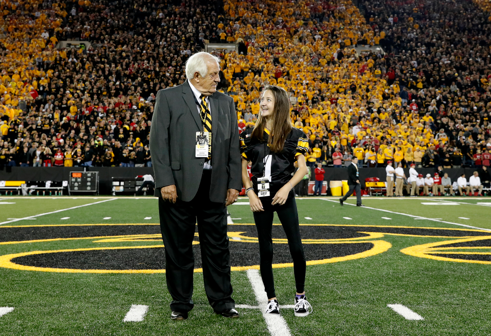 Honorary Captain Tom Moore and Kid Captain Kiersten Mann before the Iowa Hawkeyes game against the Wisconsin Badgers Saturday, September 22, 2018 at Kinnick Stadium. (Brian Ray/hawkeyesports.com)