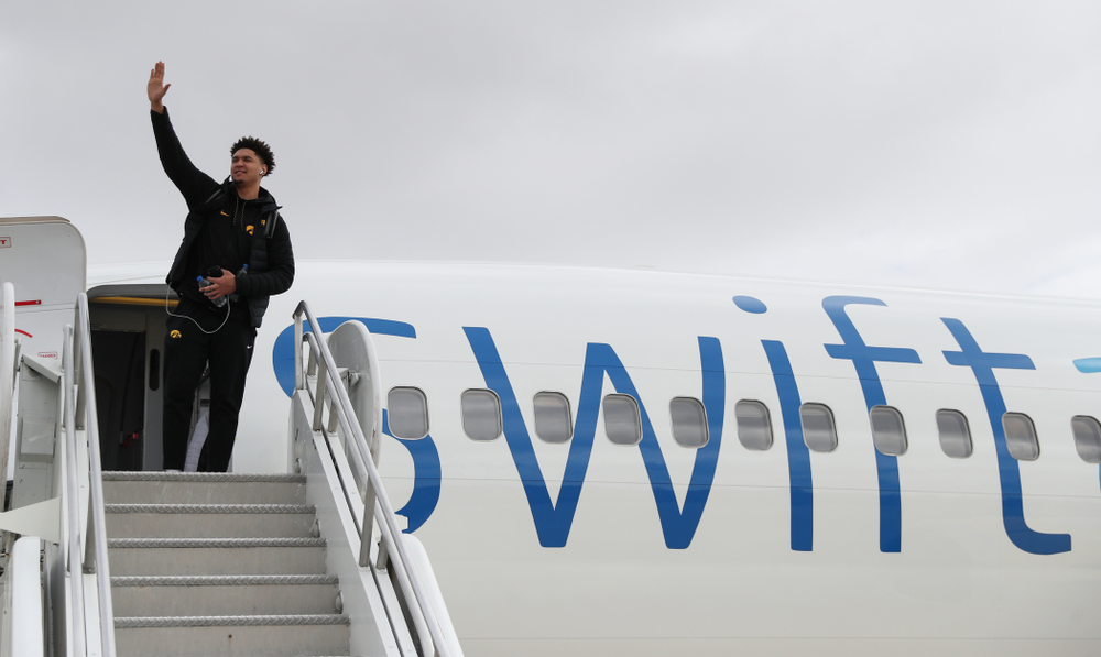 Iowa Hawkeyes forward Cordell Pemsl (35) boards a flight to Columbus for the first and second rounds of the 2019 NCAA Men's Basketball Tournament Wednesday, March 20, 2019 at the Eastern Iowa Airport. (Brian Ray/hawkeyesports.com)