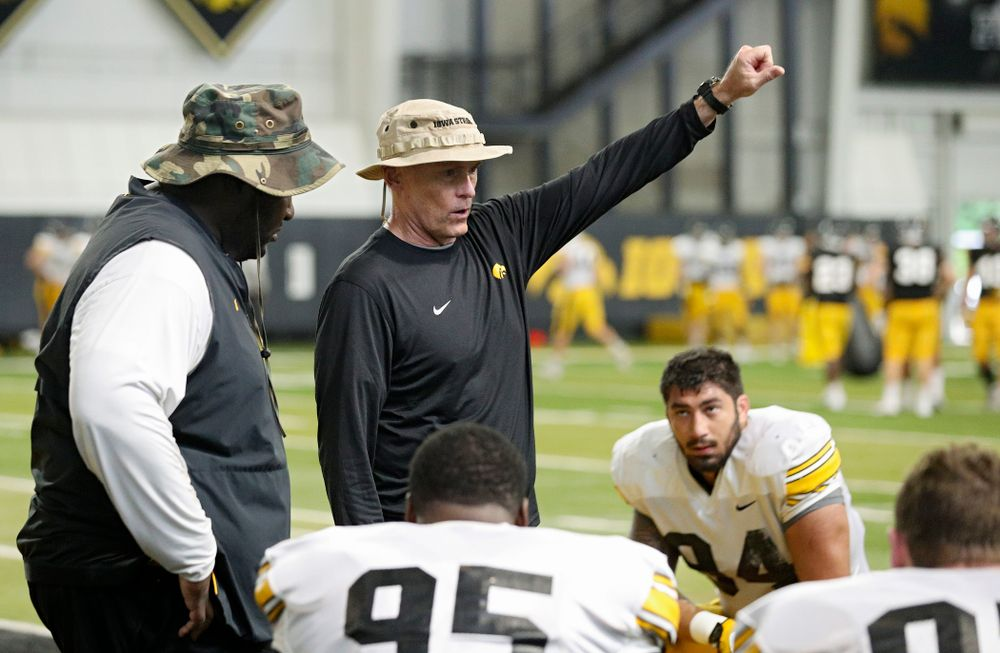 Iowa Hawkeyes assistant defensive line coach Jay Niemann (center) talks as defensive line coach Kelvin Bell (left) looks on during Fall Camp Practice No. 6 at the Hansen Football Performance Center in Iowa City on Thursday, Aug 8, 2019. (Stephen Mally/hawkeyesports.com)