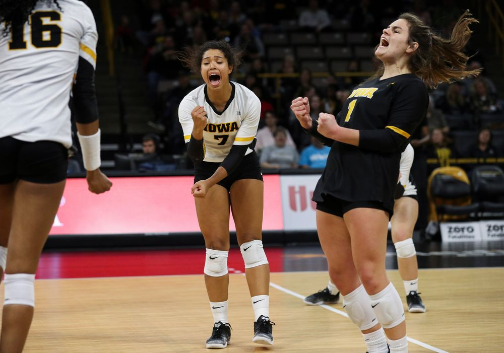 Iowa Hawkeyes setter Brie Orr (7) and Iowa Hawkeyes defensive specialist Molly Kelly (1) celebrate after winning a point during a match against Maryland at Carver-Hawkeye Arena on November 23, 2018. (Tork Mason/hawkeyesports.com)