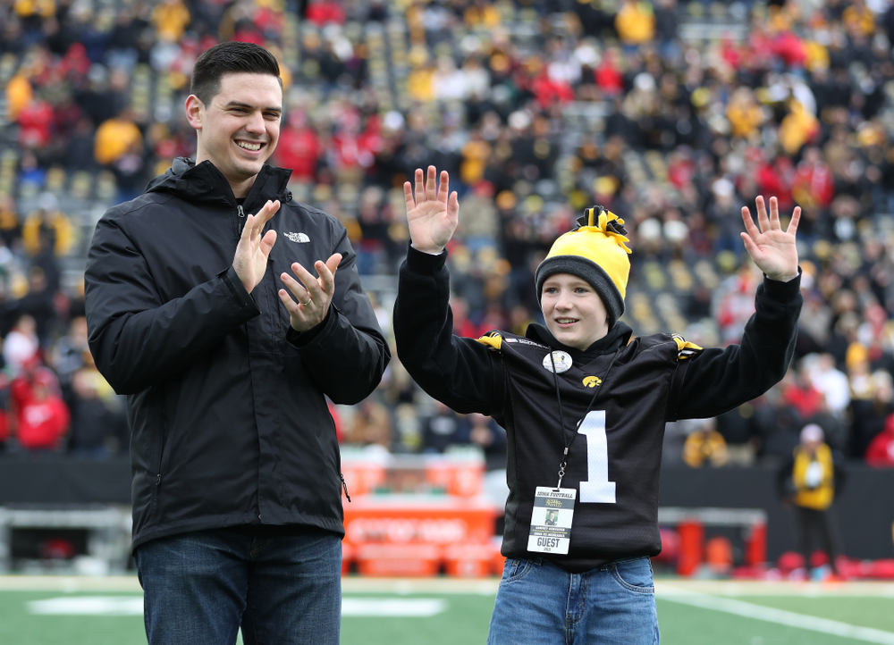 Honorary captain James Morris and Stead Family Children's Hospital Kid Captain Garret Schuster before their game against the Nebraska Cornhuskers Friday, November 23, 2018 at Kinnick Stadium. (Brian Ray/hawkeyesports.com)