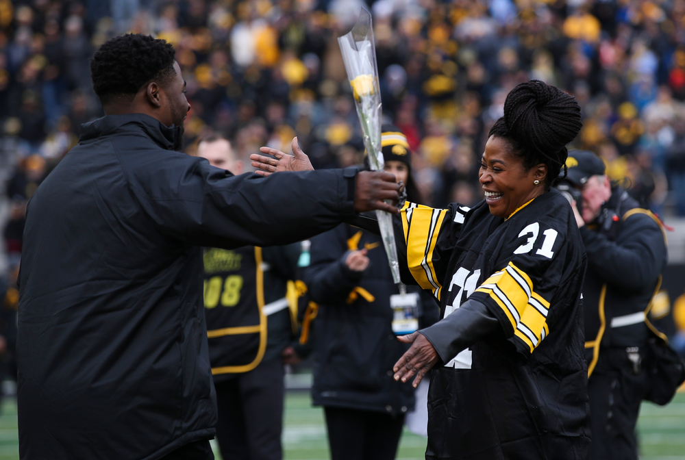 Iowa Hawkeyes linebacker Aaron Mends (31) is greeted by his mother during Senior Day ceremonies before a game against Nebraska at Kinnick Stadium on November 23, 2018. (Tork Mason/hawkeyesports.com)