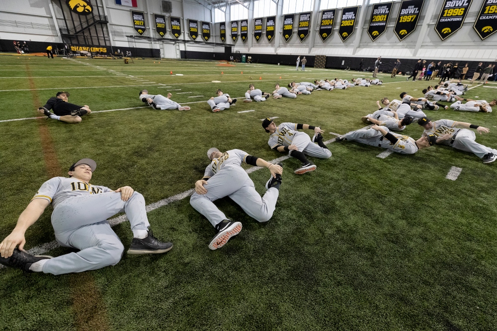 The Iowa Hawkeyes warm up for practice Tuesday, February 5, 2019 in the Indoor Practice Facility. (Brian Ray/hawkeyesports.com)