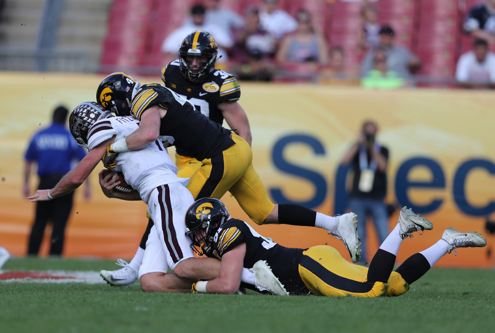 Iowa Hawkeyes defensive lineman Brady Reiff (91) and linebacker Nick Niemann (49) during the Outback Bowl Tuesday, January 1, 2019 at Raymond James Stadium in Tampa, FL. (Brian Ray/hawkeyesports.com)
