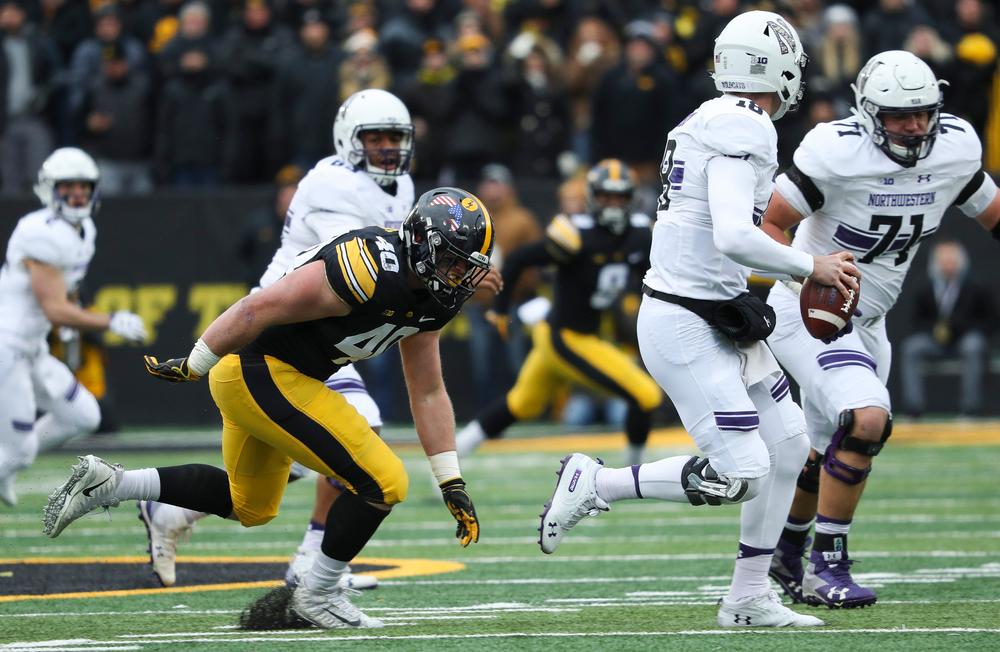 Iowa Hawkeyes defensive end Parker Hesse (40) rushes the quarterback during a game against Northwestern at Kinnick Stadium on November 10, 2018. (Tork Mason/hawkeyesports.com)