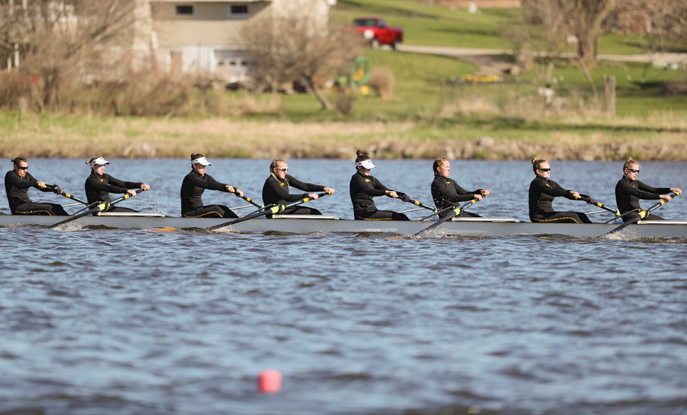 Iowa's Rachel Kram (from left), Lauren Collier, Noelle Ossenkop, Erika Davidson, Riley Seufert, Molly Rygh, Kirsten Jurgersen, and Amelia Juhl during their I Novice 8 race against Wisconsin in their Big Ten Double Dual Rowing Regatta at Lake Macbride in Solon on Saturday, Apr. 13, 2019. (Stephen Mally/hawkeyesports.com)