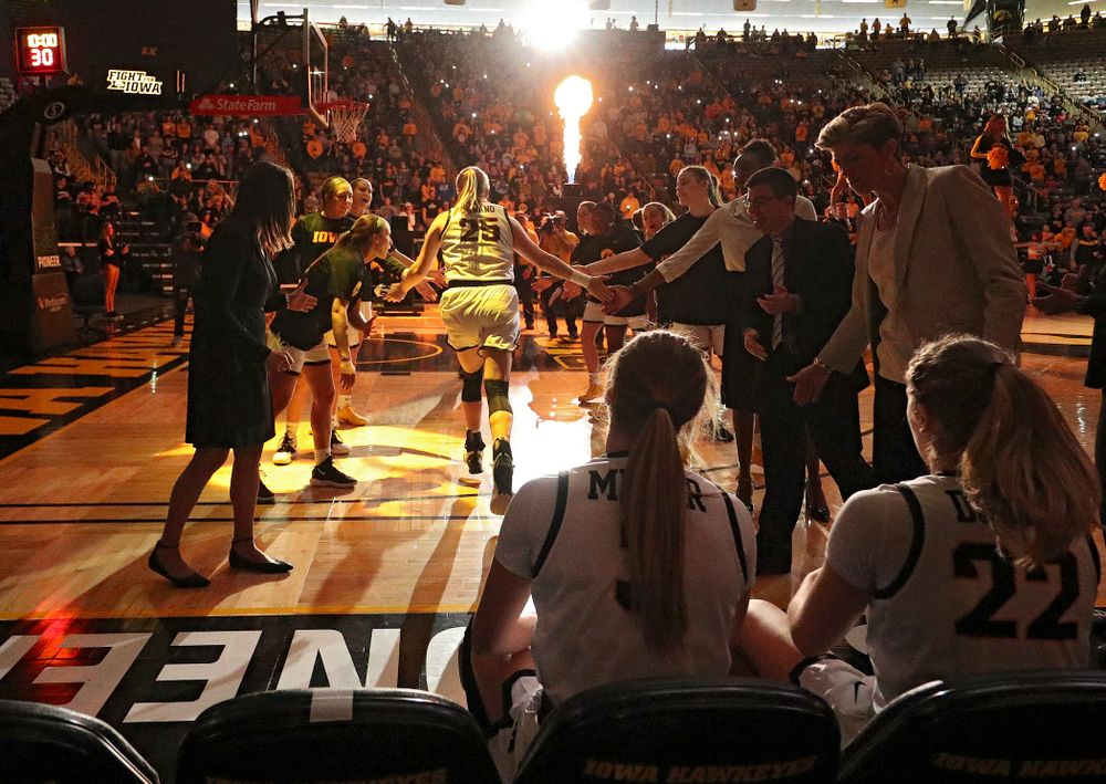 Iowa Hawkeyes forward Monika Czinano (25) is introduced before their game at Carver-Hawkeye Arena in Iowa City on Tuesday, December 31, 2019. (Stephen Mally/hawkeyesports.com)