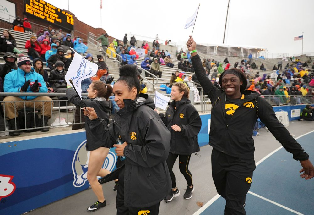 Iowa's Talia Buss (from left), Briana Guillory, Taylor Arco, and Antonise Christian take a victory lap after winning the women's sprint medley relay event during the third day of the Drake Relays at Drake Stadium in Des Moines on Saturday, Apr. 27, 2019. (Stephen Mally/hawkeyesports.com)