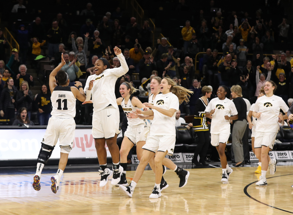 Iowa Hawkeyes guard Tania Davis (11) and guard Alexis Sevillian (5) celebrate their victory over the Rutgers Scarlet Knights Wednesday, January 23, 2019 at Carver-Hawkeye Arena. (Brian Ray/hawkeyesports.com)