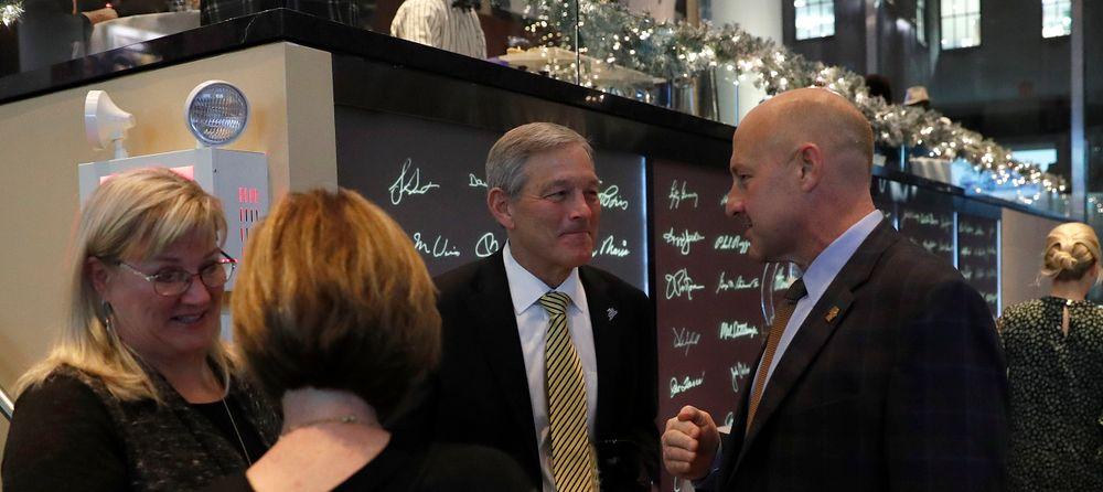 Mary Ferentz, Kirk Ferentz, Steve Addazio -- President's Welcome Reception at Yankees Steakhouse
