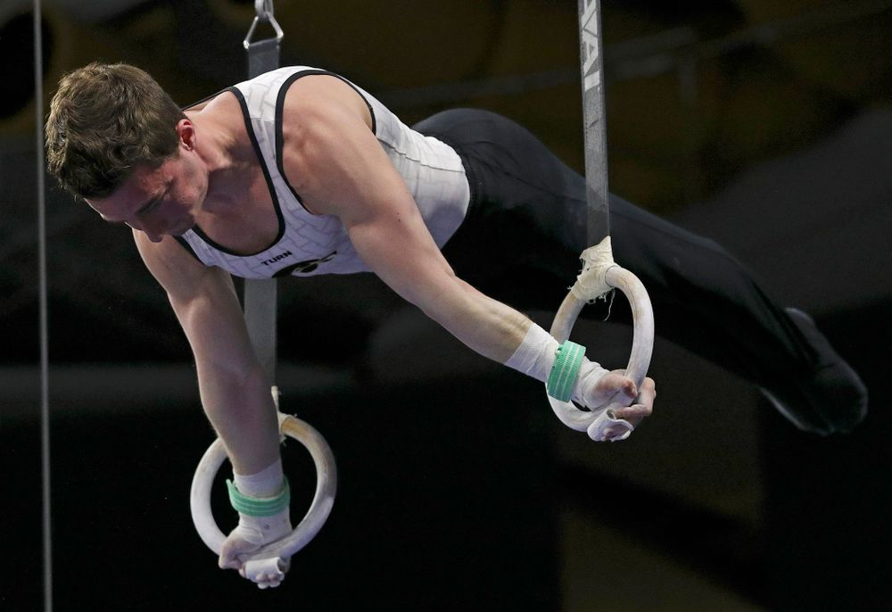 Iowa's Jake Brodarzon competes in the rings during the second day of the Big Ten Men's Gymnastics Championships at Carver-Hawkeye Arena in Iowa City on Saturday, Apr. 6, 2019. (Stephen Mally/hawkeyesports.com)