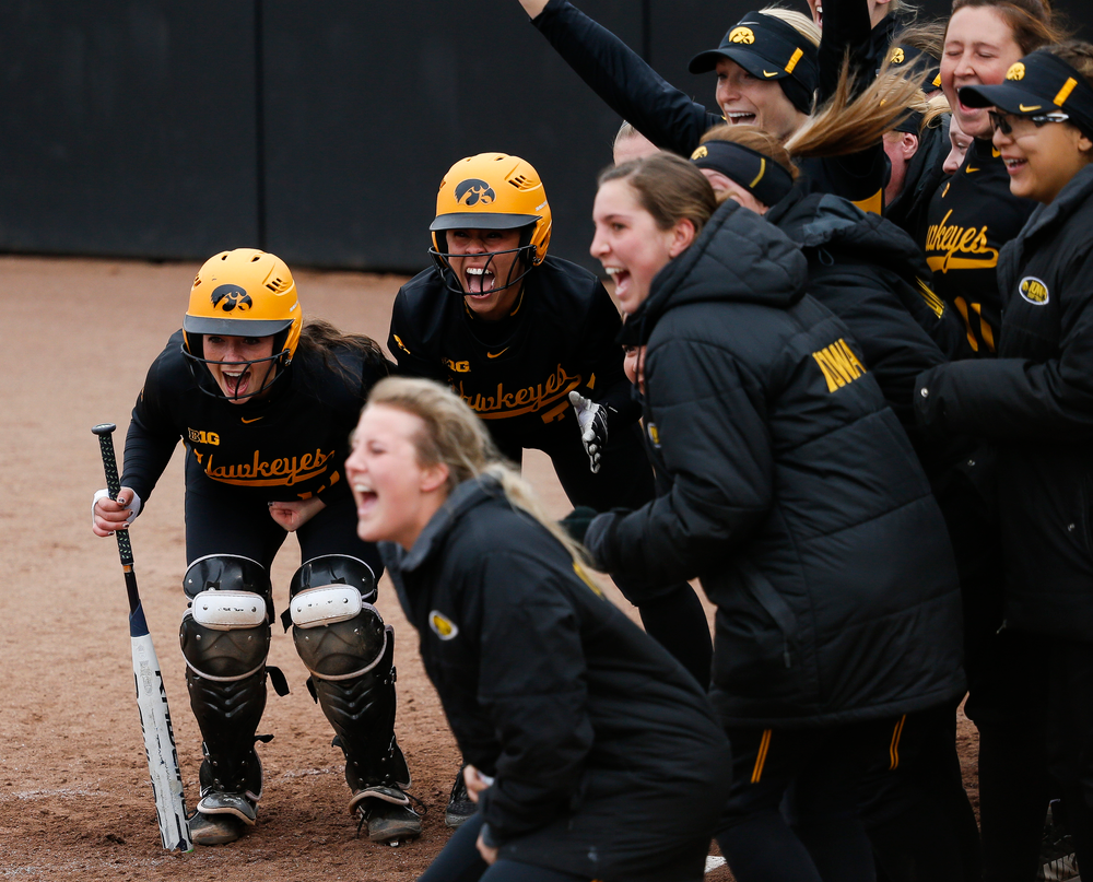 Iowa Hawkeyes catcher Angela Schmiederer (12), Iowa Hawkeyes infielder Lea Thompson (7)