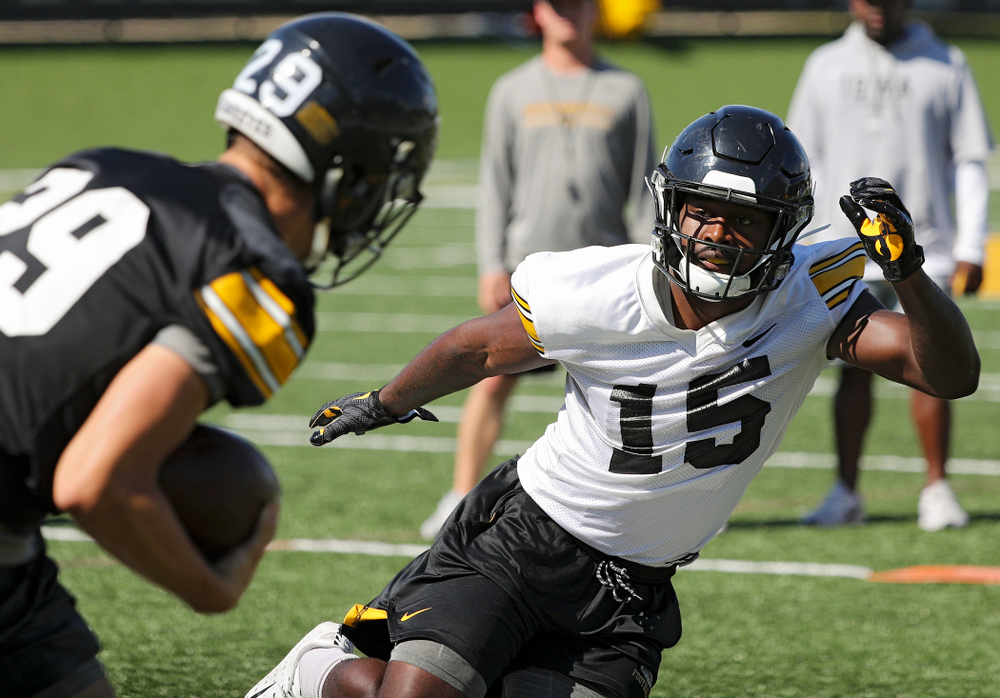 Iowa Hawkeyes defensive back Dallas Craddieth (15) eyes wide receiver Jackson Ritter (29) as they run a drill during Fall Camp Practice No. 13 at the Hansen Football Performance Center in Iowa City on Friday, Aug 16, 2019. (Stephen Mally/hawkeyesports.com)