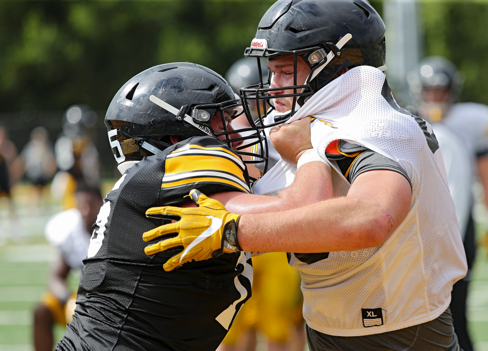 Iowa Hawkeyes offensive lineman Jeff Jenkins (75) and defensive end Logan Lee (85) run a drill during Fall Camp Practice No. 10 at the Hansen Football Performance Center in Iowa City on Tuesday, Aug 13, 2019. (Stephen Mally/hawkeyesports.com)