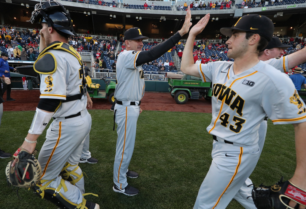 Iowa Hawkeyes head coach Rick Heller and Grant Leonard (43) against the Indiana Hoosiers in the first round of the Big Ten Baseball Tournament Wednesday, May 22, 2019 at TD Ameritrade Park in Omaha, Neb. (Brian Ray/hawkeyesports.com)
