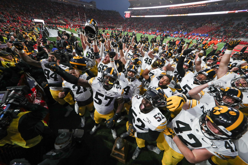 The Iowa Hawkeyes sing the Fight Song following their win against the Nebraska Cornhuskers Friday, November 29, 2019 at Memorial Stadium in Lincoln, Neb. (Brian Ray/hawkeyesports.com)