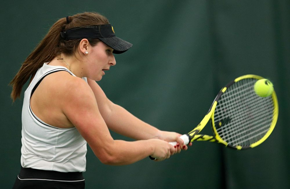 Iowa's Danielle Bauers returns a shot during her singles match at the Hawkeye Tennis and Recreation Complex in Iowa City on Sunday, February 16, 2020. (Stephen Mally/hawkeyesports.com)