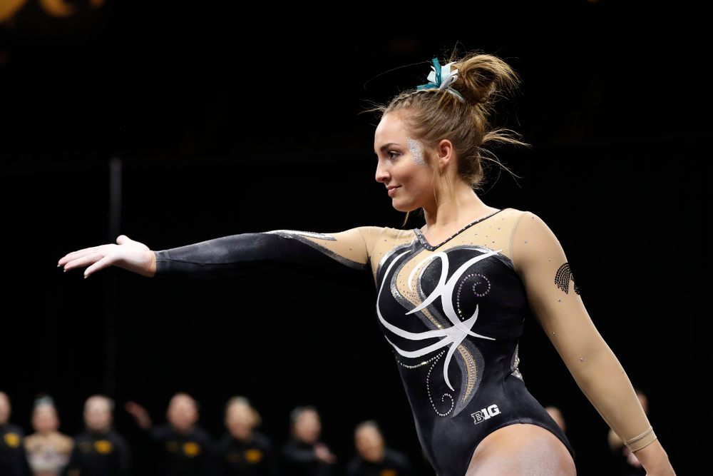 Iowa's Bre Fitzke competes on the floor against the Nebraska Cornhuskers