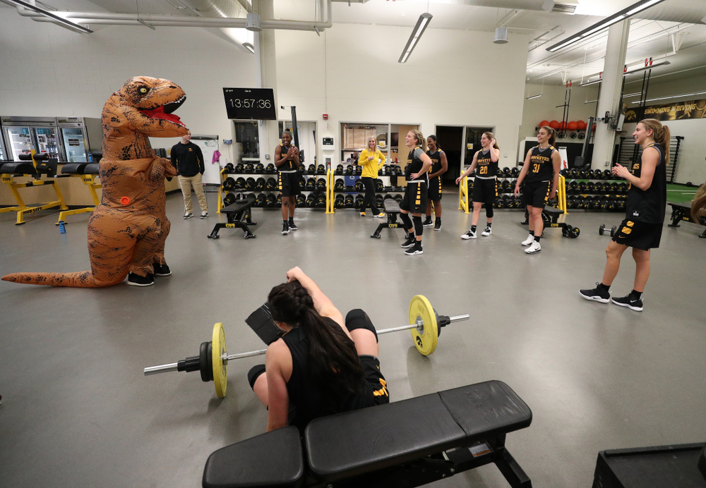 Iowa Hawkeyes head coach Lisa Bluder  surprises her team during a workout dressed as a T-Rex for Halloween  Wednesday, October 31, 2018 at Carver-Hawkeye Arena. (Brian Ray/hawkeyesports.com)