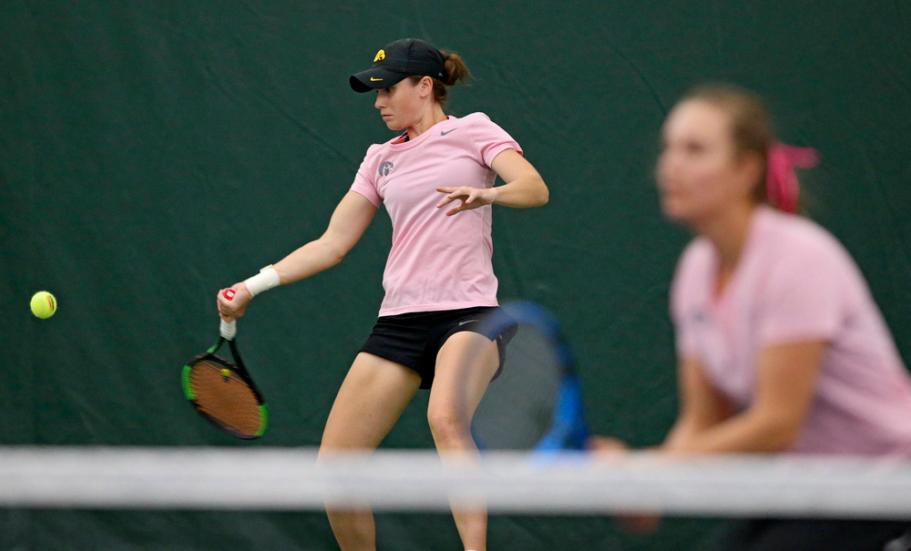 Iowa's Elise van Heuvelen Treadwell (left) lines up a shot as Ashleigh Jacobs looks on during their doubles match against Purdue at the Hawkeye Tennis and Recreation Complex in Iowa City on Friday, Mar. 29, 2019. (Stephen Mally/hawkeyesports.com)