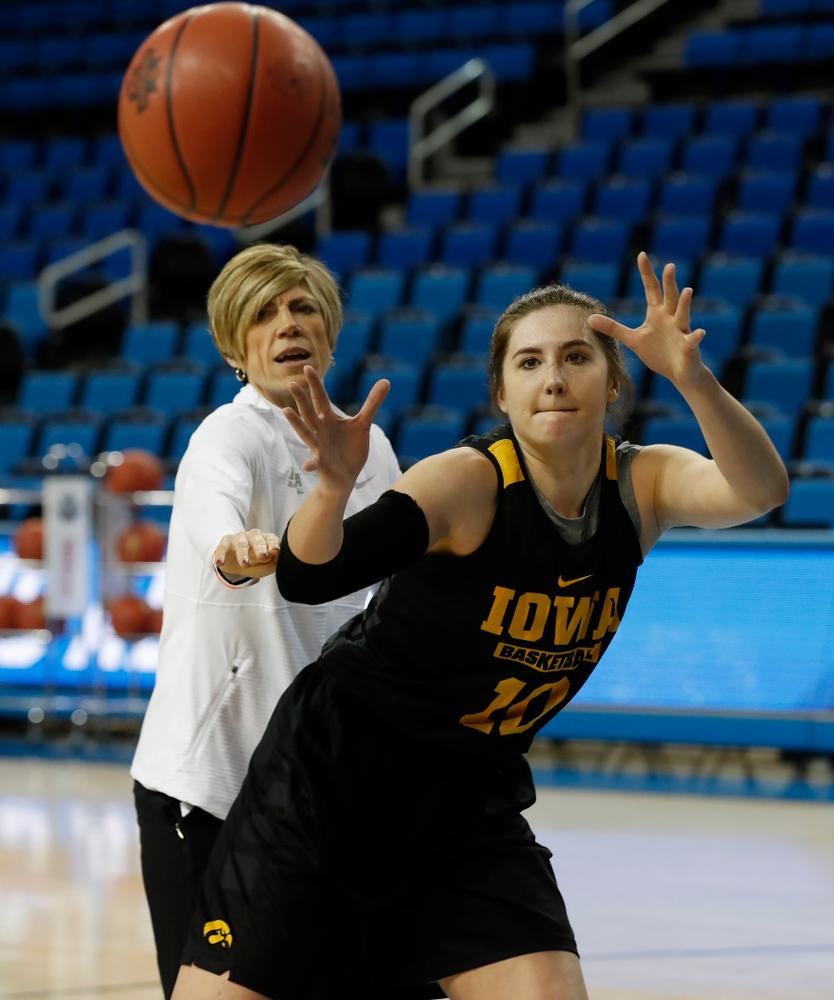 Iowa Hawkeyes forward Megan Gustafson (10) works against associate head coach Jan Jensen during practice Friday, March 16, 2018 at Pauley Pavilion on the campus of UCLA. (Brian Ray/hawkeyesports.com)