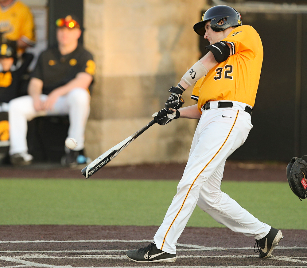 Iowa Hawkeyes catcher Brett McCleary (32) drives a pitch for a hit during the eighth inning of their game against Northern Illinois at Duane Banks Field in Iowa City on Tuesday, Apr. 16, 2019. (Stephen Mally/hawkeyesports.com)