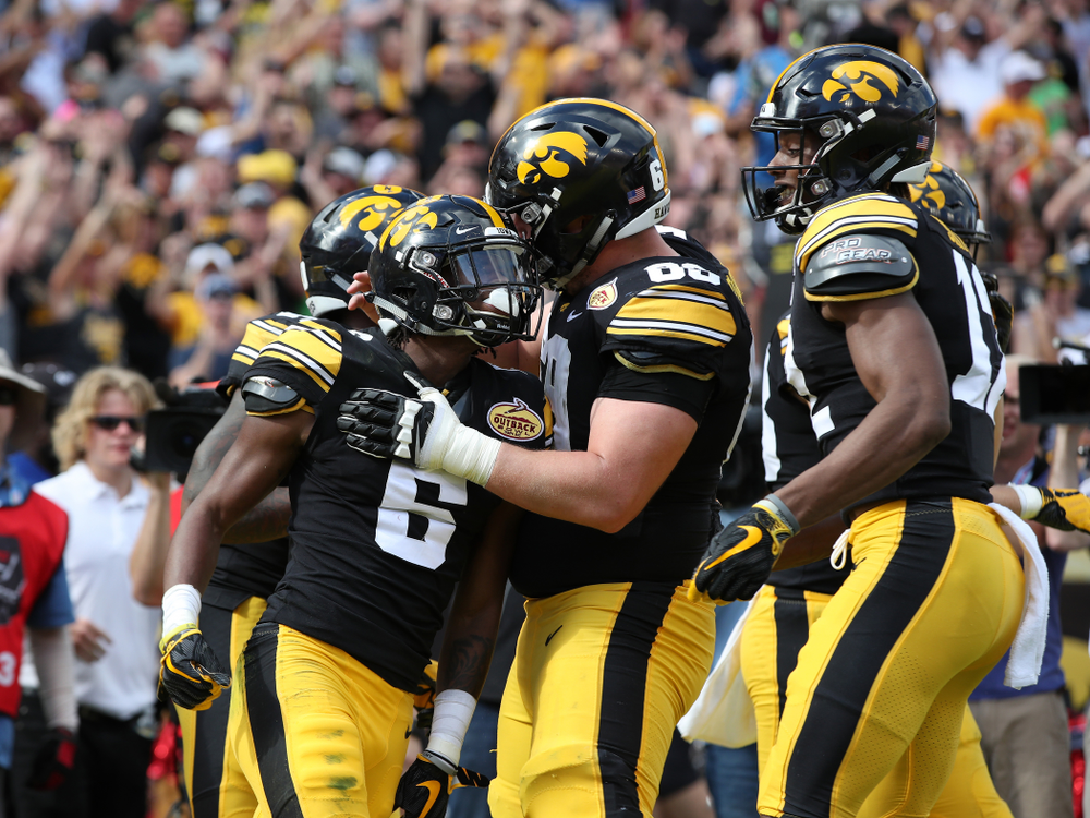 Iowa Hawkeyes wide receiver Ihmir Smith-Marsette (6) and offensive lineman Keegan Render (69) during their Outback Bowl Tuesday, January 1, 2019 at Raymond James Stadium in Tampa, FL. (Brian Ray/hawkeyesports.com)