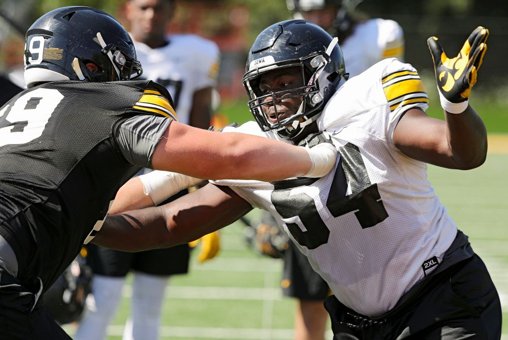 Iowa Hawkeyes defensive tackle Daviyon Nixon (54) tries to get around offensive lineman Tyler Endres (69) during Fall Camp Practice No. 7 at the Hansen Football Performance Center in Iowa City on Friday, Aug 9, 2019. (Stephen Mally/hawkeyesports.com)