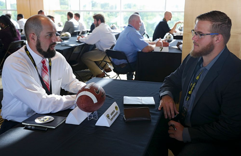 Andrew Fenstermaker (from left), former Iowa punter, talks with offensive lineman Landan Paulsen as former players meet with members of the current Hawkeye Football team during a networking event at Kinnick Stadium in Iowa City on Thursday, Jun 6, 2019. (Stephen Mally/hawkeyesports.com)