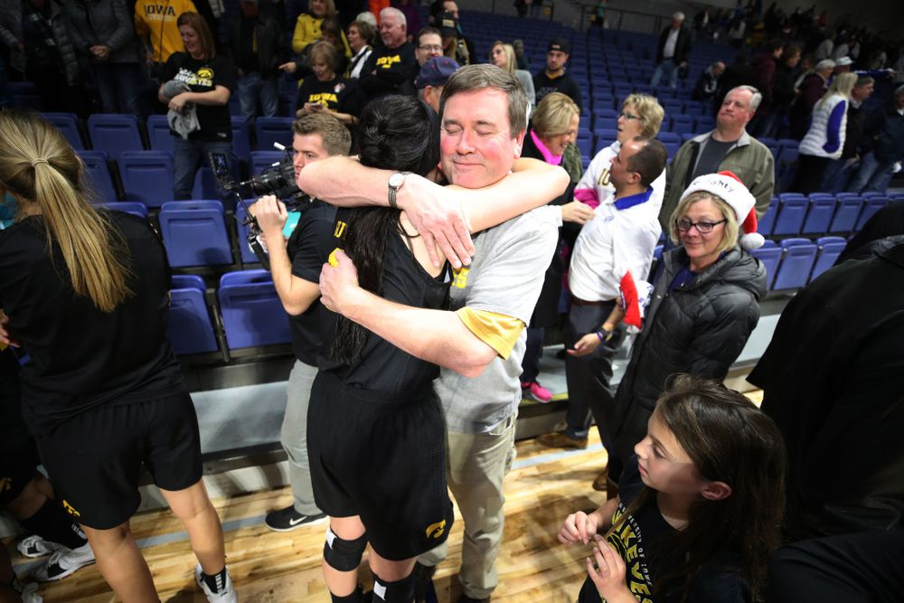 Iowa Hawkeyes forward Megan Gustafson (10) hugs her father Clendon following their win over the Drake Bulldogs Friday, December 21, 2018 at the Knapp Center in Des Moines. (Brian Ray/hawkeyesports.com)