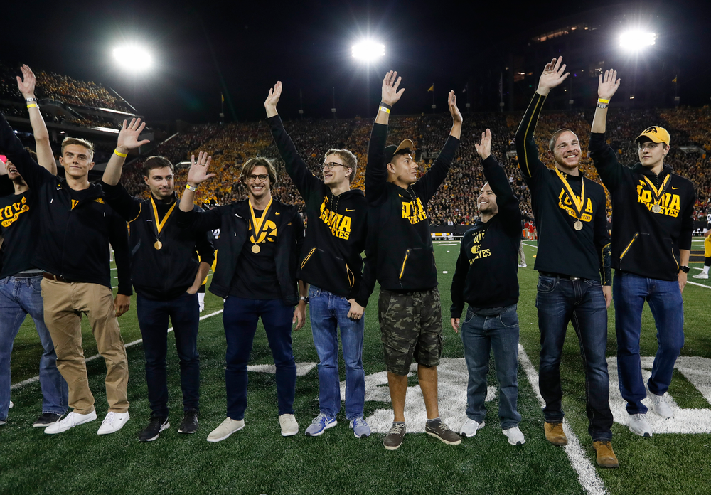 Members of the Iowa men's swimming and diving team are recognized by the Presidential Committee on Athletics at halftime during a game against Wisconsin on September 22, 2018. (Tork Mason/hawkeyesports.com)